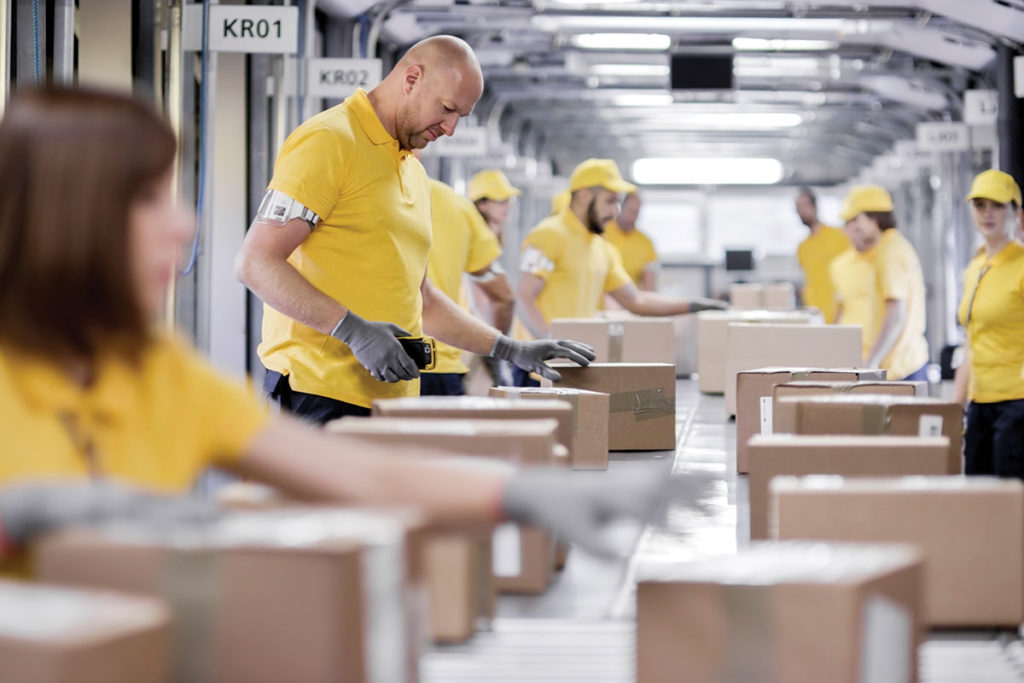 People working a packaging line